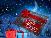 Flying gift card and presents against twinkling stars