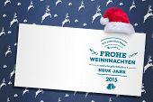 German christmas greeting against blue reindeer pattern