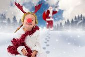 Cute little girl wearing red nose and tinsel against blue sky with white clouds