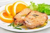 image of pork cutlet  - Pork cutlets with orange sauce on white plate close up view - JPG