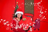 Young brunette with christmas present against red background