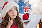Cute girl in santa hat against blue sky with white clouds