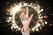 Businesswoman pointing against 2015