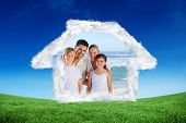 Portrait of a cute family at the beach against green field under blue sky