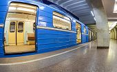 Blue Subway Train Standing At The Underground Station. Wide Angle