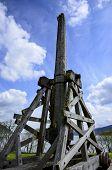image of trebuchet  - Trebuchet at Urquhart Castle in Scotland against a blue sky - JPG
