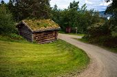 Countryside landscape with ancient old historic wooden house in Norway