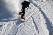 Snowboard freerider in the snowy mountains