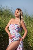 Happy Woman With Dreadlocks On Nature Background