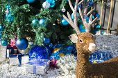 Christmas Reindeer, Decoration Style With Christmas Tree And Christmas Gifts On Background