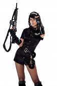 stock photo of cap gun  - Portret of beautiful sexy policewoman with handcuffs in a black uniform that aiming a submachine gun - JPG