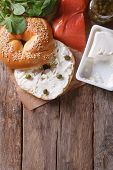 Traditional Bagel With Salmon And Ingredients Vertical Top View