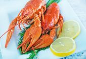 image of crawfish  - boiled crawfish with fresh lemon on the plate - JPG