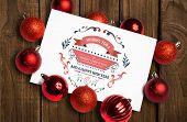 Christmas greetings against overhead of wooden planks