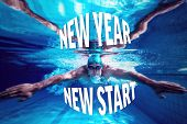 Fit swimmer training by himself against new year new start