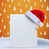 Santa hat on poster against orange tree pattern