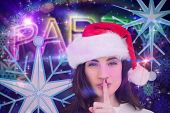 Festive brunette keeping a secret against digitally generated colourful party text