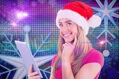 Festive blonde using tablet pc against digitally generated cool disco background