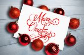 Merry christmas message against bleached wooden planks background