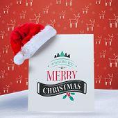Christmas message against red reindeer pattern