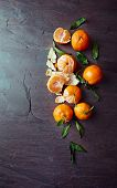 Mandarin oranges on a slate surface