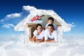 Family in their new house lying on floor with boxes against bright blue sky with clouds