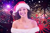 Woman in santa hat with hair in the wind against digitally generated cool nightlife background