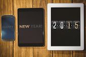 2015 against tablet and smartphone on desk