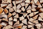 Close up of dry chopped firewood on stock prepared for winter