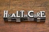 healthcare word in mixed vintage metal type printing blocks over grunge wood