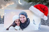 image of north-pole  - young winter couple against cute christmas village at north pole - JPG
