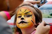 pic of lion  - Cute little girl with face painted like a lion - JPG