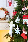 Christmas handmade decorations on Christmas tree  on light home interior background
