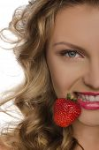 Young Woman With Strawberry Teeth