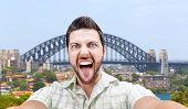 Happy young man taking a selfie photo in Sydney, Australia