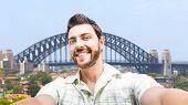 Happy young man taking a selfie photo in Sydney, Australia