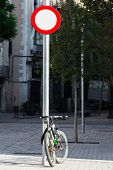 bike and a road sign in the city