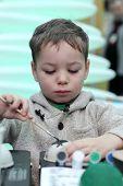 Boy Paints A Cardboard Toy