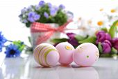 image of paint pot  - blue campanula flowers in flower pot and easter painted eggs - JPG