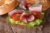 Bagel With Ham And Vegetables Close-up. Horizontal