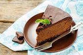 picture of cheesecake  - chocolate cheesecake with chocolate glaze on dark wood background - JPG