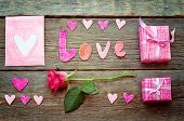 Valentine's Background With Gift, Flower, Card And Word Love