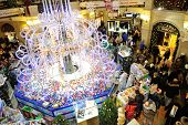 Christmas Fair, Illumination And Buyers In Gum Store
