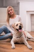 Beautiful  blond girl with Labrador Retriever