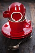 Valentine's day composition with coffee cups on wooden background