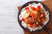 Pork Meat In Sweet And Sour Sauce With Rice Noodles Top View