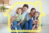 Smiling family watching TV together against house outline