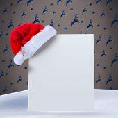 Santa hat on poster against grey reindeer pattern