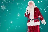 Santa sings like a Superstar against green