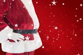 Santa Claus belly from the side against red snowflake background